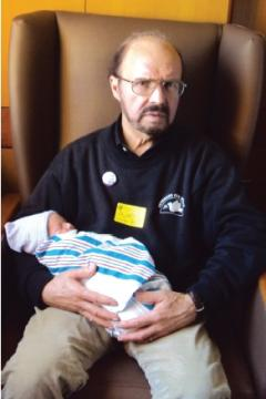 Arny holding his new grandson (born in March). Photo: Stieber family
