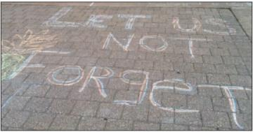 "Chalked messages in front of the ""Justice"" Center in memory of Raul Pinet, Jr., who was killed there in August 2010. Photo: Barrie Gewanter."