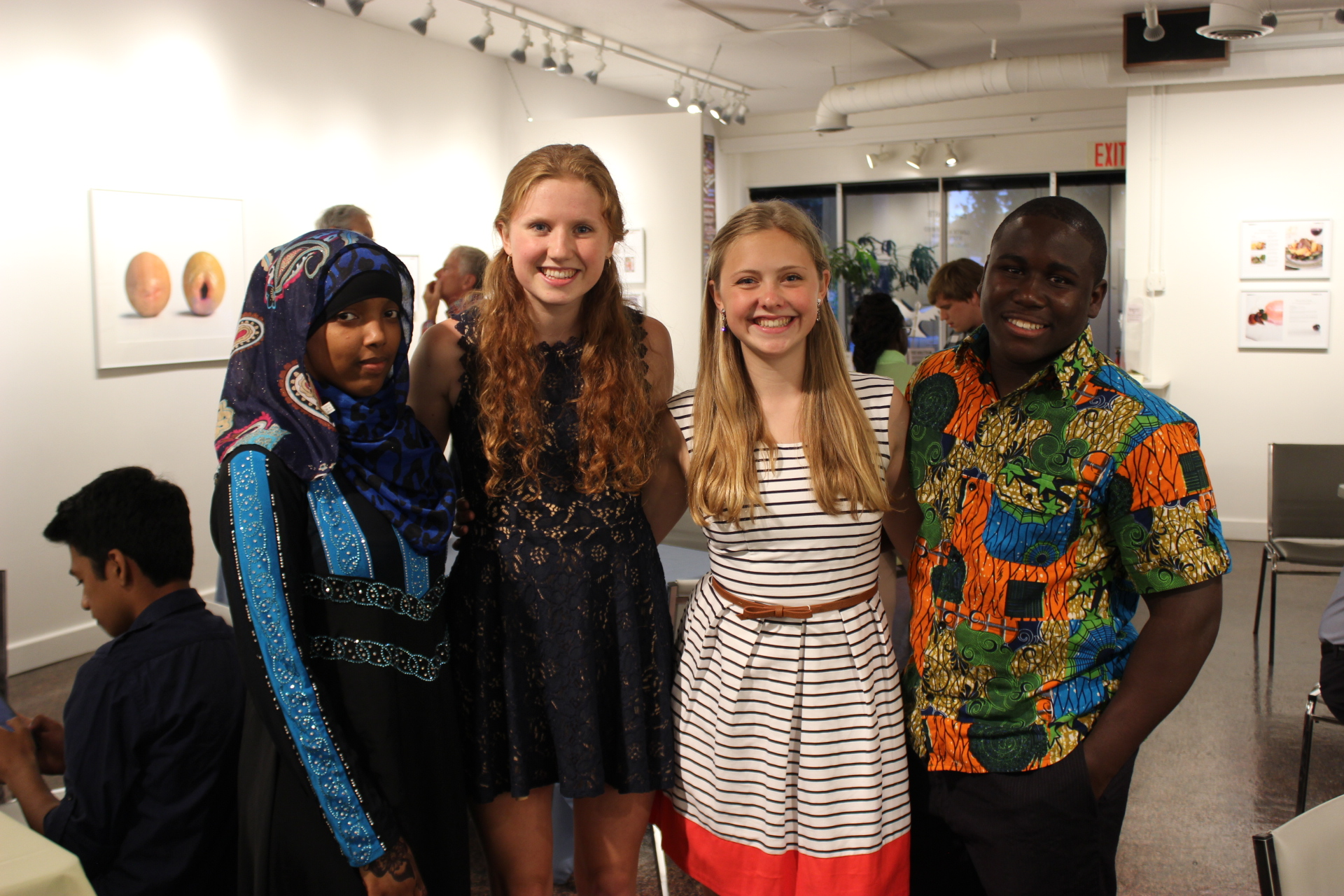 Students at a previous Youth Peace Award posing for a photo at ArtRage.
