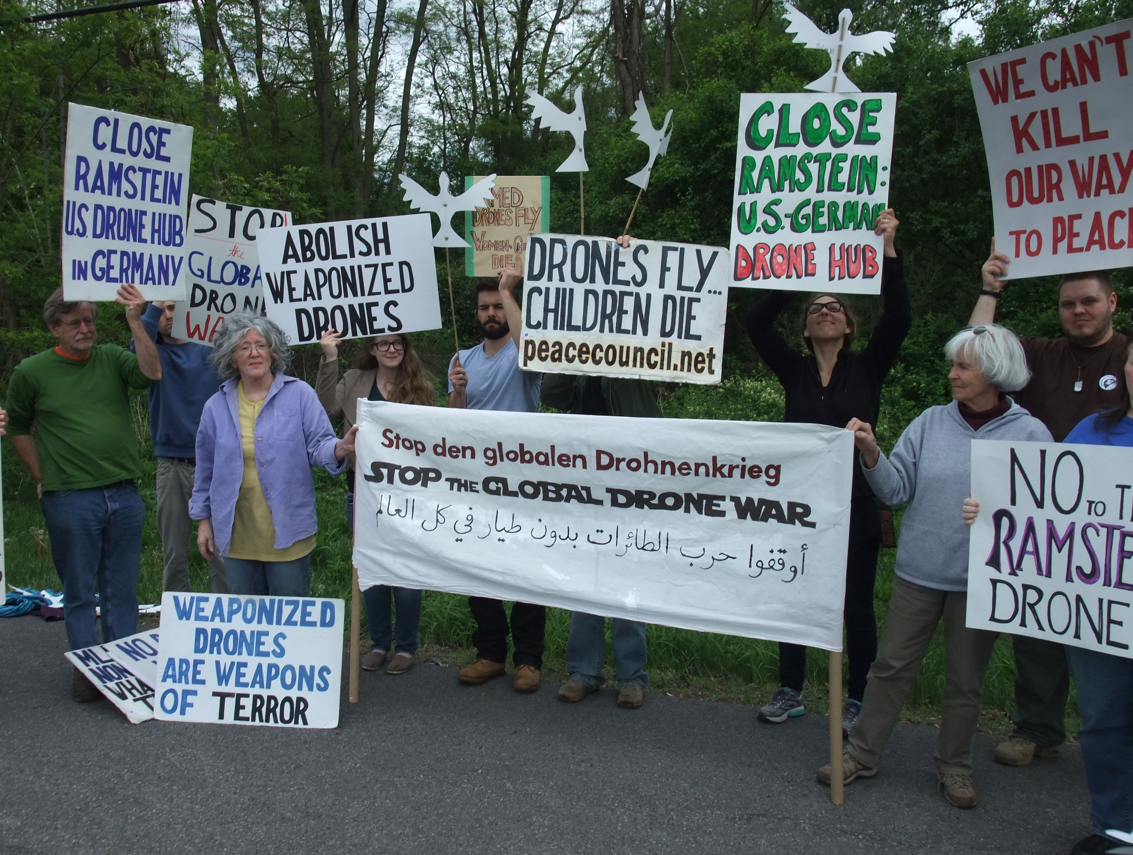 SPC activists demonstrate outside of Hancock Airbase on May 21