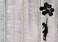 stencil by Banksy on apartheid wall