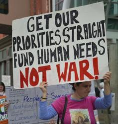 Invest in Communities Not War