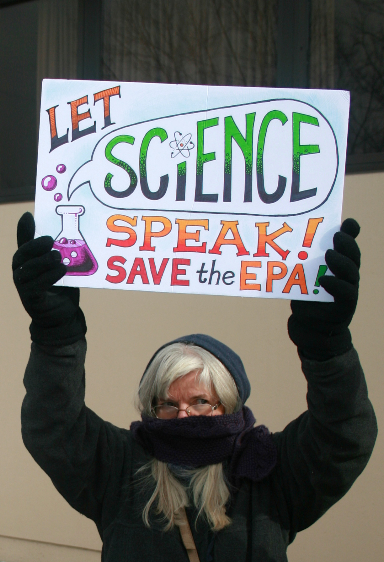 "Protester carrying ""Let Science Speak/Save the EPA"" Sign"