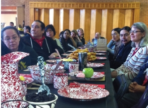 Attendees gather for a traditional Pawnee dinner, prepared by Haskell Indian Nations University students. Photo: Lindsay Speer