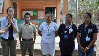 Ursula translating for a delegation visit to the community health team of El Paisnal. Photo: Alison Aguilar
